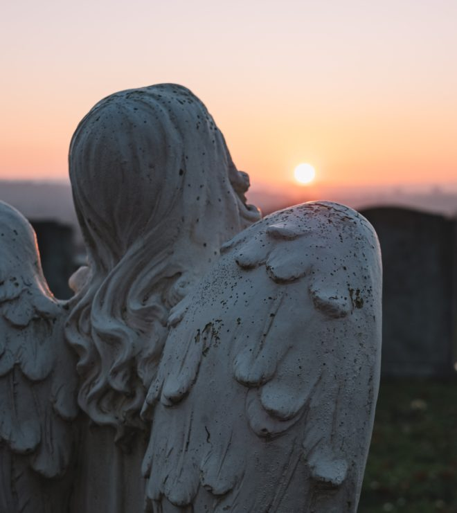 Angel at burial grounds at sunrise